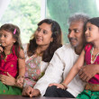 Indian family looking to side — Foto de Stock