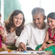 Indian family playing carrom game — Stock Photo