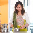 Indian housewife preparing food — Stock Photo #47663513