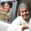 Indian father driving new car. — Foto Stock