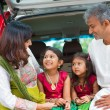 Indian family in car infront new house. — Stock Photo #47663579