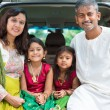 Indian family sitting in car. — Stock Photo