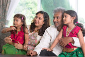 Indian family looking to side — Stock Photo