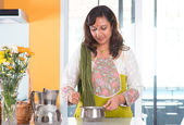 Indian housewife preparing food — Stock Photo