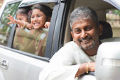 Indian father driving new car. — Stock Photo
