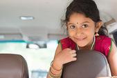 Indian girl in car — Stock Photo