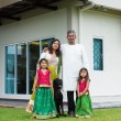 Family with their new house. — Stock Photo #48145939