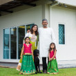 Family with their new house. — Stock Photo