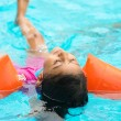 Little girl swimming — Stock Photo #48146133