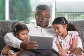 Grandfather and granddaughters — Stock Photo