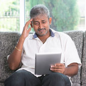 Headache while reading on tablet computer  — Stock Photo