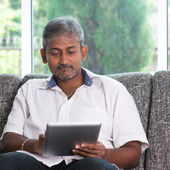 Reading on digital tablet computer  — Stock Photo