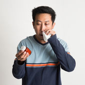 Asian male sneezing  — Stock Photo