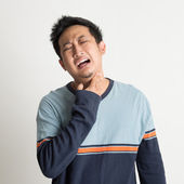 Asian male sore throat — Stock Photo