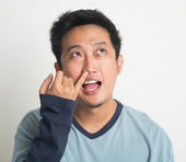 Asian man picking nose — Stock Photo