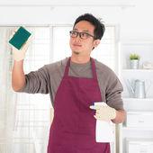 Asian man doing house chores — Stok fotoğraf