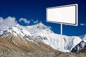 Blank billboard surround by mountain range. — Stock Photo