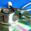 Stethoscope on CD concepts of information integrity and data security — Stock Photo