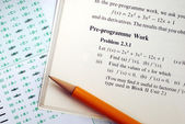 Answer a complicated mathematics question in an exam or test — Stock Photo