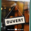 The Open sign in French concepts of business — Stockfoto