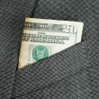 Money in a business suit pocket concepts of business finance — Stock Photo