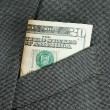 Money in a business suit pocket concepts of business finance — ストック写真