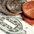Coins and dollar bill concepts of money investing and wealth - Stock Photo