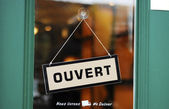 The Open sign in French concepts of business — Stock Photo