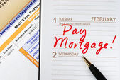 Be sure to pay the home mortgage on time — Stock Photo