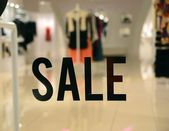 On Sale sign at the store front concept of discount shopping — Stock Photo