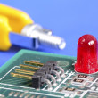 A red warning lamp in a computer hardware concept of troubleshooting and maintenance — Stock Photo