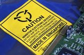 Electrostatic Warning Label and Computer Circuit board — Stock Photo