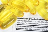 Nutrition label with fish oil pills concept healthy eating — Stock Photo
