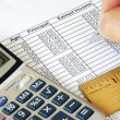 Stock Photo: Calculate capital gain and income with calculator