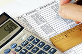 Calculate the capital gain and income with the calculator — Stock Photo