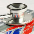 A stethoscope on the credit card concepts of checking the financial health and security — Stock Photo