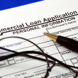 File the commercial loan application isolated on blue — Stock Photo