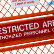 A security sign outside a restricted area — Photo