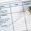 Stock Photo: Vaccination record concept of disease prevention and immunization