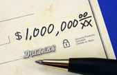 Write a check of one million dollars concept of wealth — Stock Photo