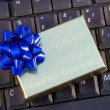 Holiday gift box on a keyboard concepts of holiday online shopping — Stock Photo #3614906