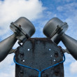 Outdoor public address loudspeakers against a blue sky — Stock Photo