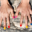 Stock Photo: Two female hand with the fashionable color nail polish