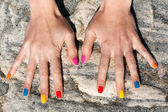 Two female hand with the fashionable color nail polish — Stockfoto