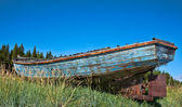 Beached fishing trawler to give a well worn vintage look — Стоковое фото
