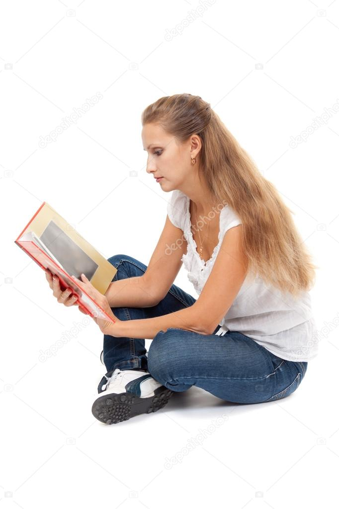 Beautiful girl in lotus position to read books. Isolate on white background. — Stock Photo #13217519