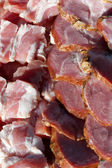 Fresh meats packed in rows — Stock Photo