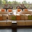 Cafe with sofas and cushions, palm - Stock Photo
