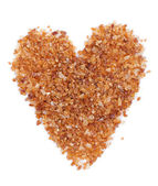 Brown sugar with a shape of heart — Stock Photo