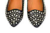 Black women's leather ballet flats with steel rivets close up — Stok fotoğraf